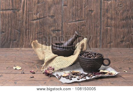 Mortar With Pestle And A Vintage Cup With Coffee Beans On Homespun Canvas