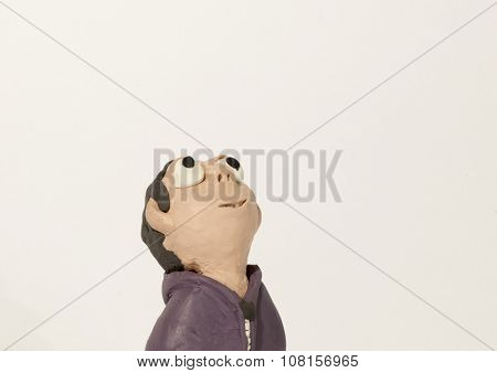 Plasticine character. Boy looking up