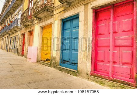 Colorful Worn Painted Doors Along Street In Portugal - Artistic Concept - Warm Filter Look