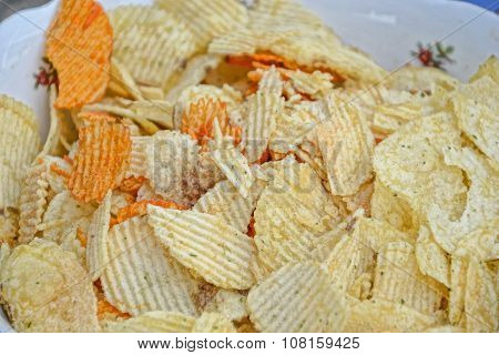 Close Up Of Heap Of Grooved Potato Crisp / Chips In Bowl