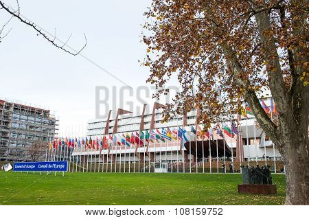 STRASBOURG FRANCE - 14 Nov 2015: All European Union Flag flies at half-mast in front of the Council of Europe following an terrorist attack in Paris