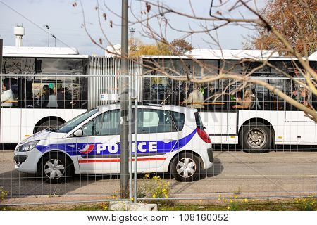 STRASBOURG FRANCE - NOV 14 2015: French Police checking vehicles on the 'Bridge of Europe' between Strasbourg and Kehl Germany as a security measure in the wake of attacks in Paris - officer body searching bus travelers