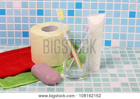 Toothbrush and soap on a tile in bathroom