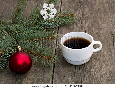 Still Life A Fir-tree Branch With Brightly Red Ornament And A Cup Of Coffee