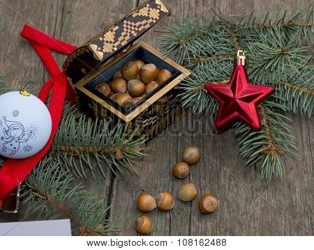Christmas, Casket With Forest Nutlets Decorated With A Fir-tree Branch With Ornament