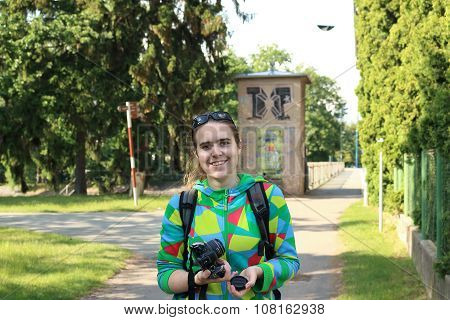 Smiling Girl Holding Camera On Pedestrian Zone In Podebrady
