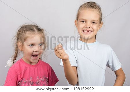 Four-year Girl With Surprise Stares At The Lost Tooth In His Hand A Six-year Girl