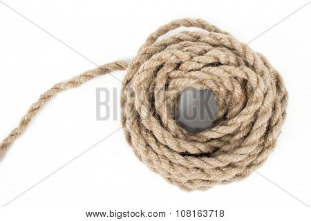 Hank of rough rope isolated on a white background.
