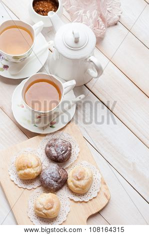 Cream Puff(choux Cream) With A Cup Of Tea On White Wooden Board, Afternoon Tea Relaxing Time Concept