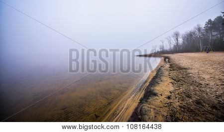 Foggy empty beach on the Ottawa River.