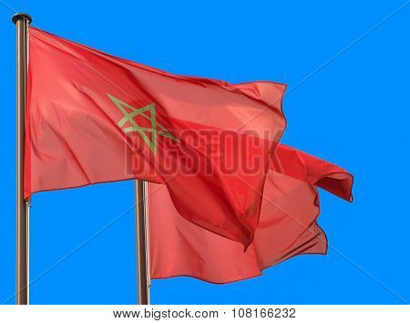 Morocco Flags Waving In Blue Sky