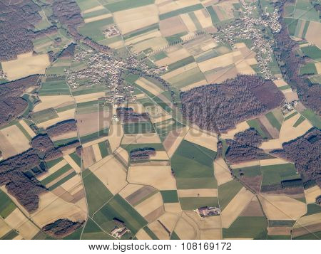 aerial view of patchwork of farms and village in Alsace Lorraine, France