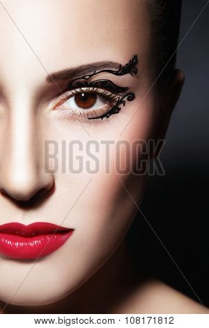 Close-up portrait of young beautiful woman with fancy paper eye stickers