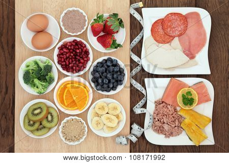 High protein super food diet of meat, fish and eggs, with fruit, vegetable and acai berry and maca supplement powder with tape measure. Also eaten by body builders.