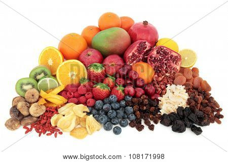 Large superfood fresh fruit selection over white background.
