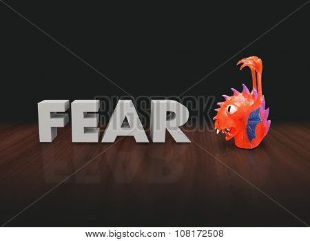 Fear word in 3d white letters beside a red plastic finger puppet monster