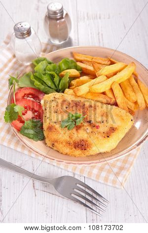 plate with cordon bleu and french fries