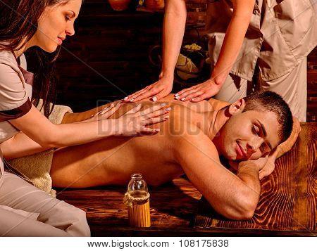 Handsome caucasian man having oil Ayurveda spa treatment.