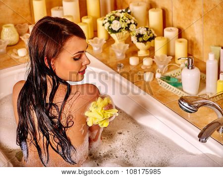 Young woman enjoing in hot bath.