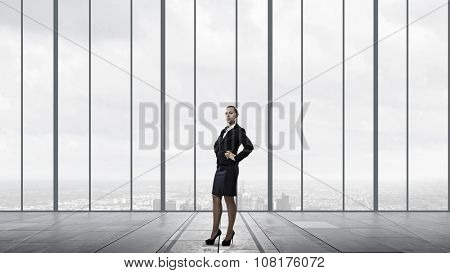 Young confident businesswoman with hand on waist