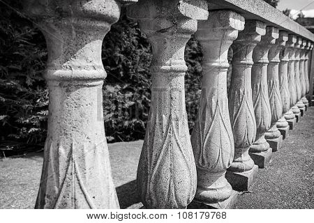 An old stone balustrade in perspective.