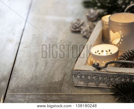 Christmas candles on wooden background. Christmas background
