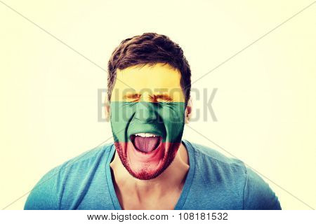 Screaming man with Lithuania flag painted on face.