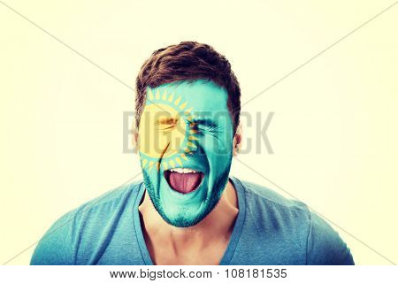 Screaming man with Kazakhstan flag painted on face.
