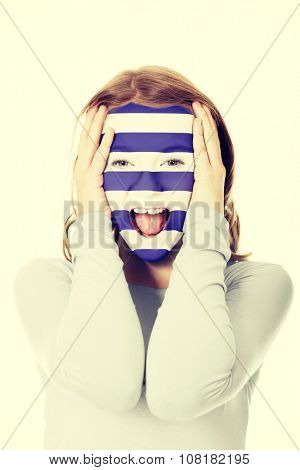 Woman with painted greece flag on face.