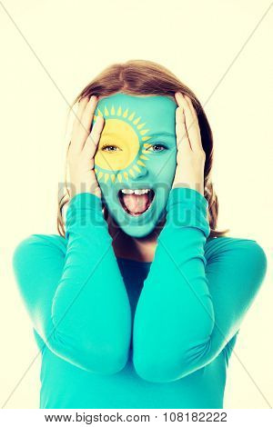 Woman with Kazakhstan flag painted on face.