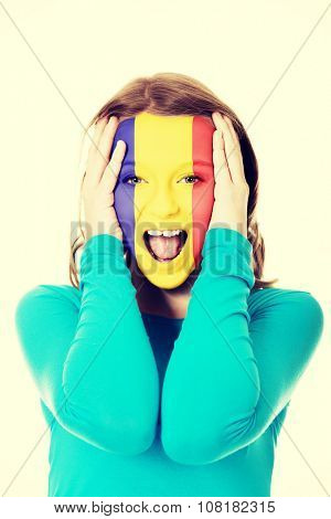 Woman with Andora flag painted on her face.