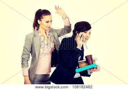 Businesswoman try to get attention from her busy partner.