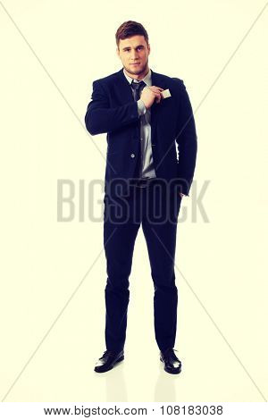 Handsome businessman taking his personal card from pocket.