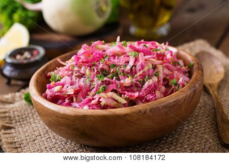 Pink daikon salad with apples, pickled onions and parsley.