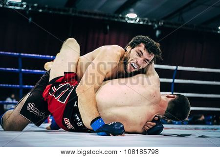 two athletes MMA ground fighting