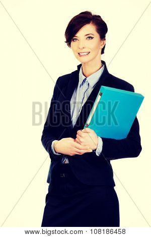 Beautiful businesswoman holding a binder.