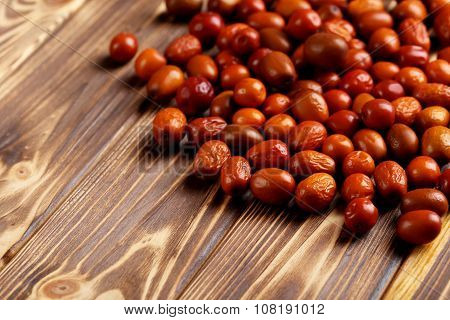 Ripe Jujubes On Brown Wooden Table, Close Up