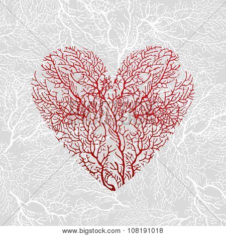 Card with heart of red coral