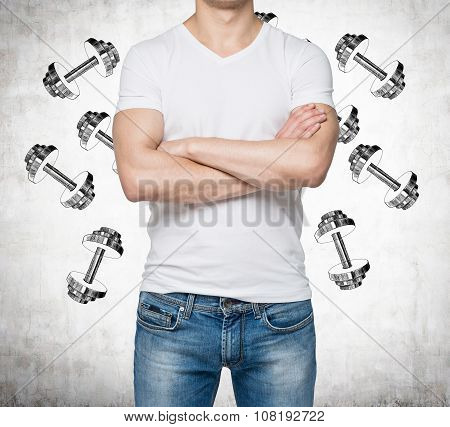 A Man With Crossed Hands Is Pondering About Weights. Weight Icons Are Drawn Over The Concrete Backgr