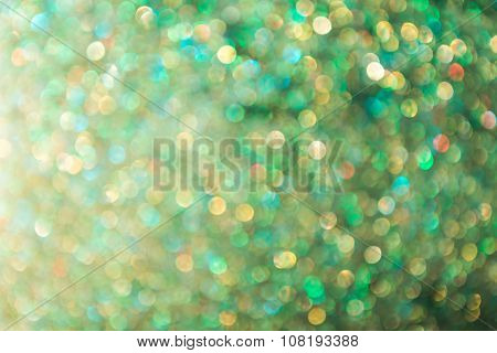 Defocused glittering green lights for abstract background.