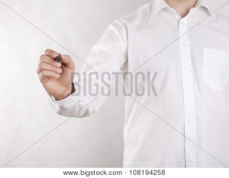 Young man writing with black marker. Clipping path included.