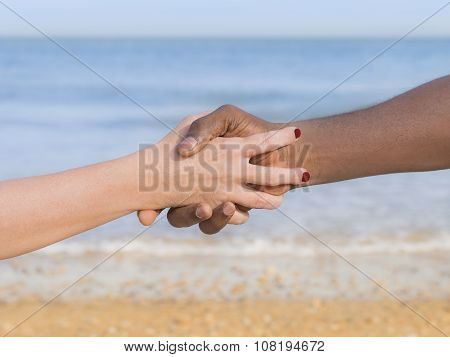 Man and woman holding each other s hand, symbol of love and diversity