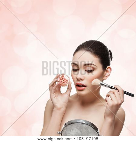 Girl applying blush