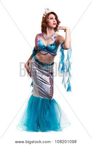 Carnival dancer woman dressed as a mermaid posing, isolated on white