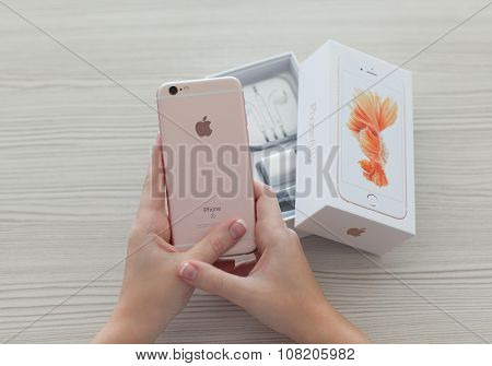 Woman Hands Unpacking Iphone6S Rose Gold