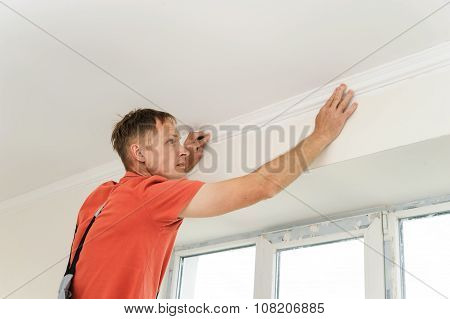 Installation Of Ceiling Moldings.