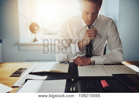 Serious Business Man Working On Documents
