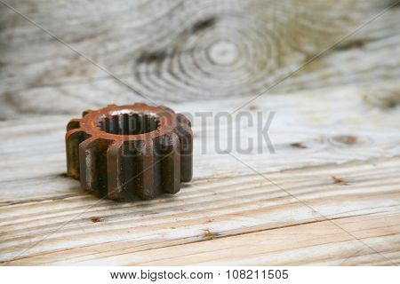 gear on wooden background, Machine parts or spare parts, industry background