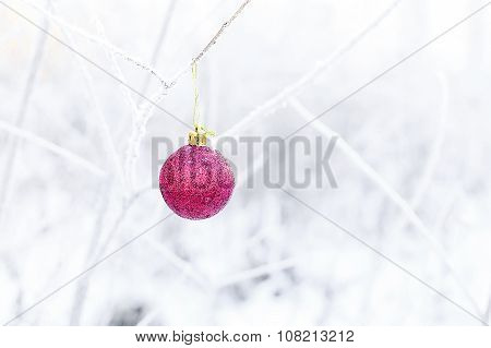 Red Christmas balls on the background of snowy forest