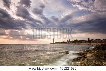 Beacon On The Cape Chersonese In Sevastopol On A Sunset